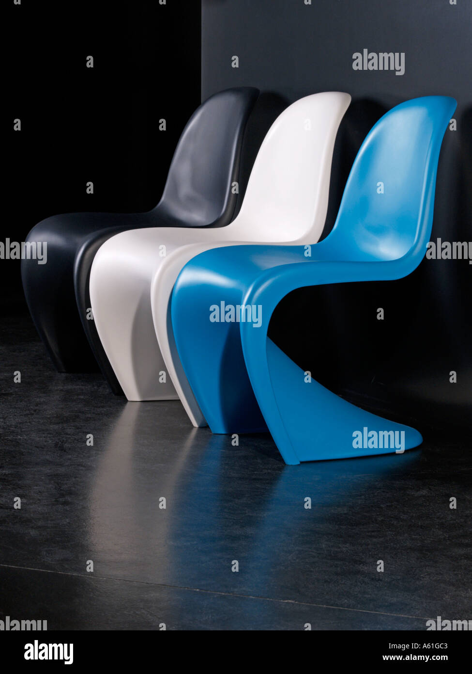 three plastic design chairs in the famous 1960 s sixties design by