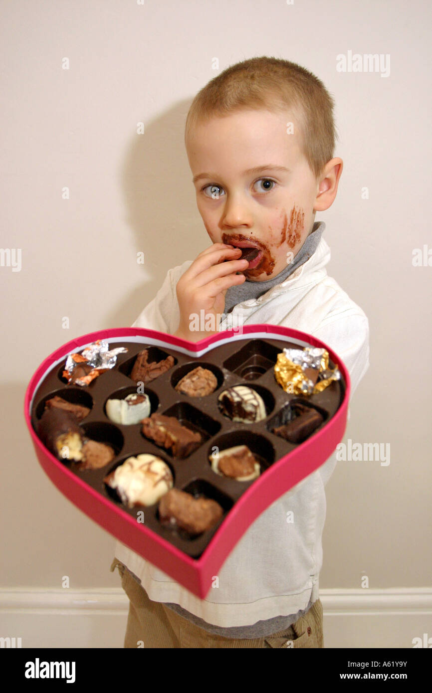 Valentines day. Young boy with chocolate smeared all over face ...