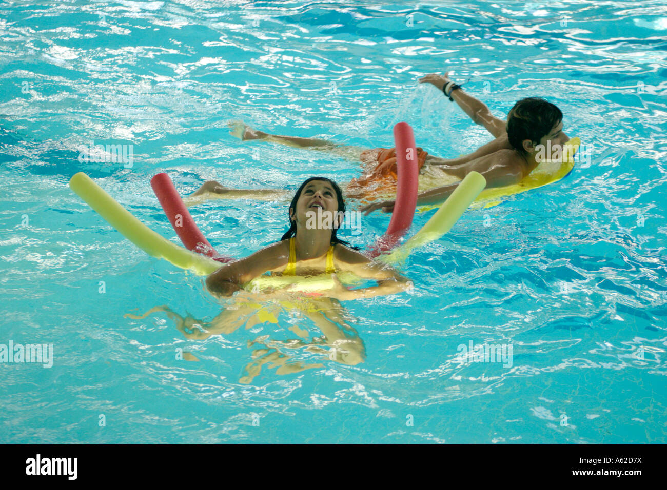 Interesting Kids Public Swimming Pool Photo Children With Floatation Devices At To Ideas