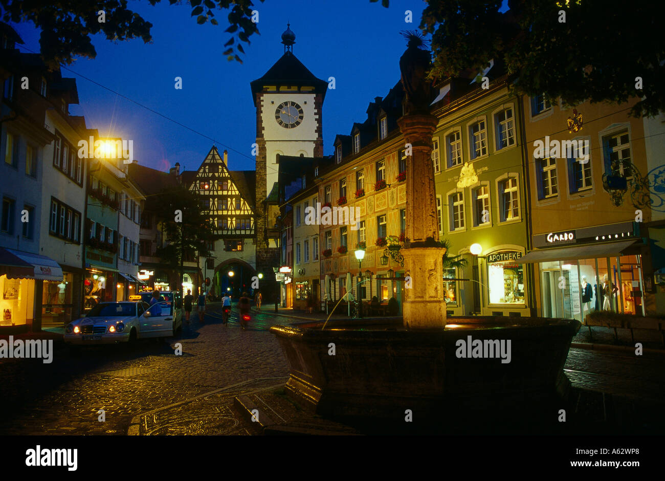 buildings lit up at night freiburg im breisgau baden wuerttemberg stock photo royalty free. Black Bedroom Furniture Sets. Home Design Ideas