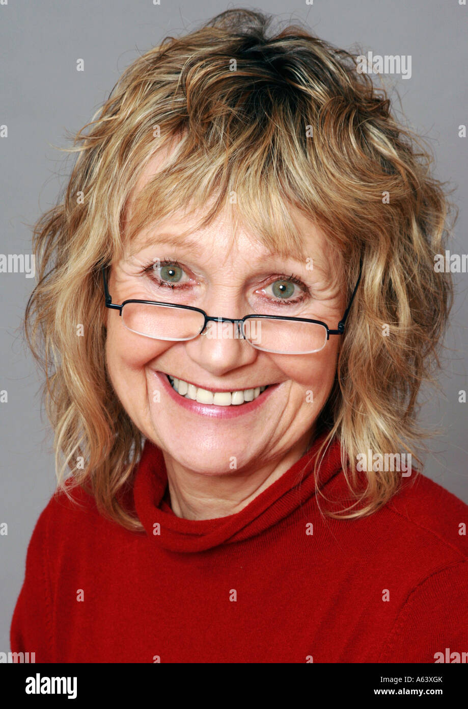 Smiling Sixty Year Old Woman Wearing Glasses Stock Photo