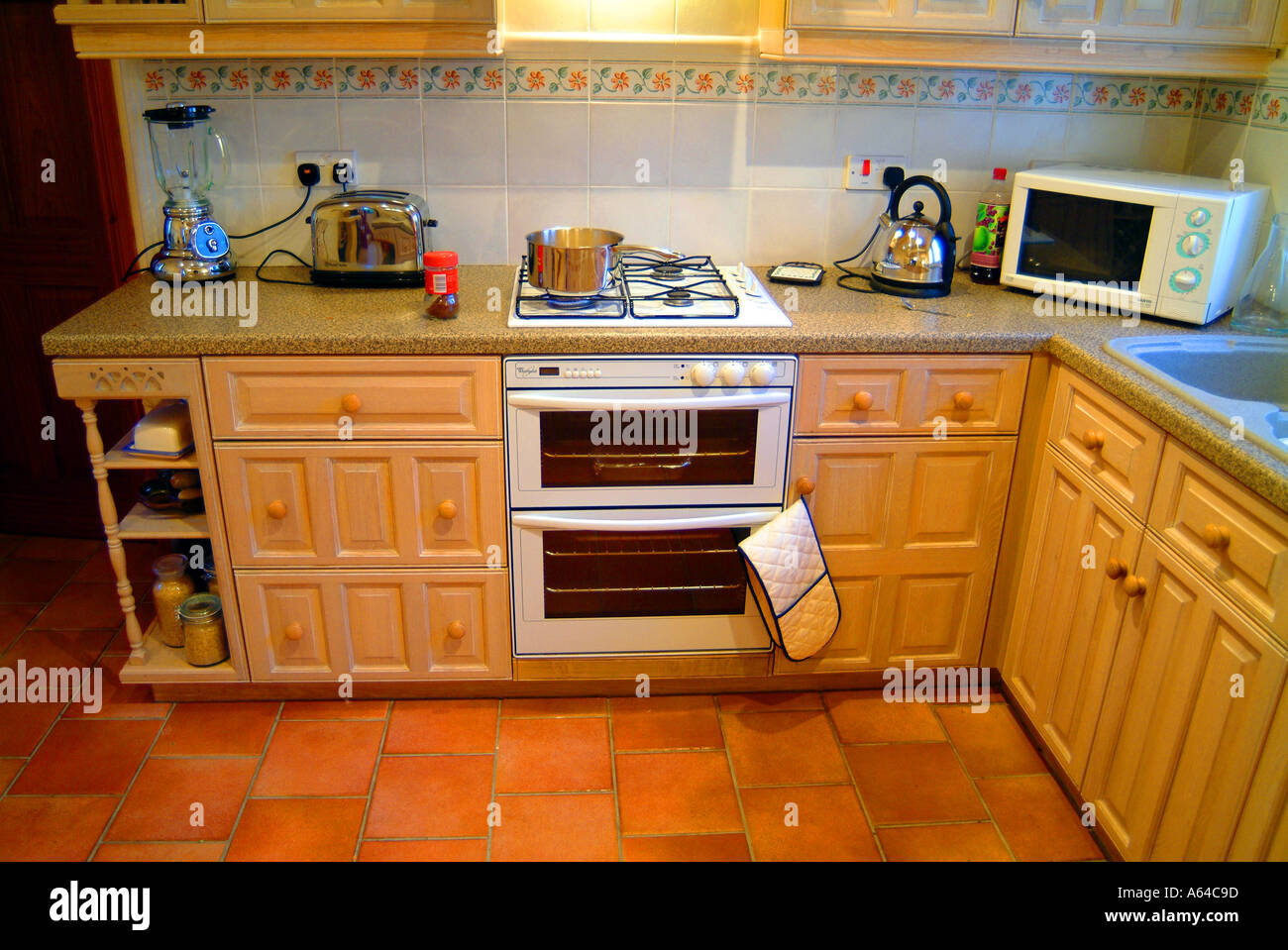 open oven in kitchen. stock photo - kitchen oven chrome kettle toaster blender microwave open plan interior domestic home house room empty nobody food micr in