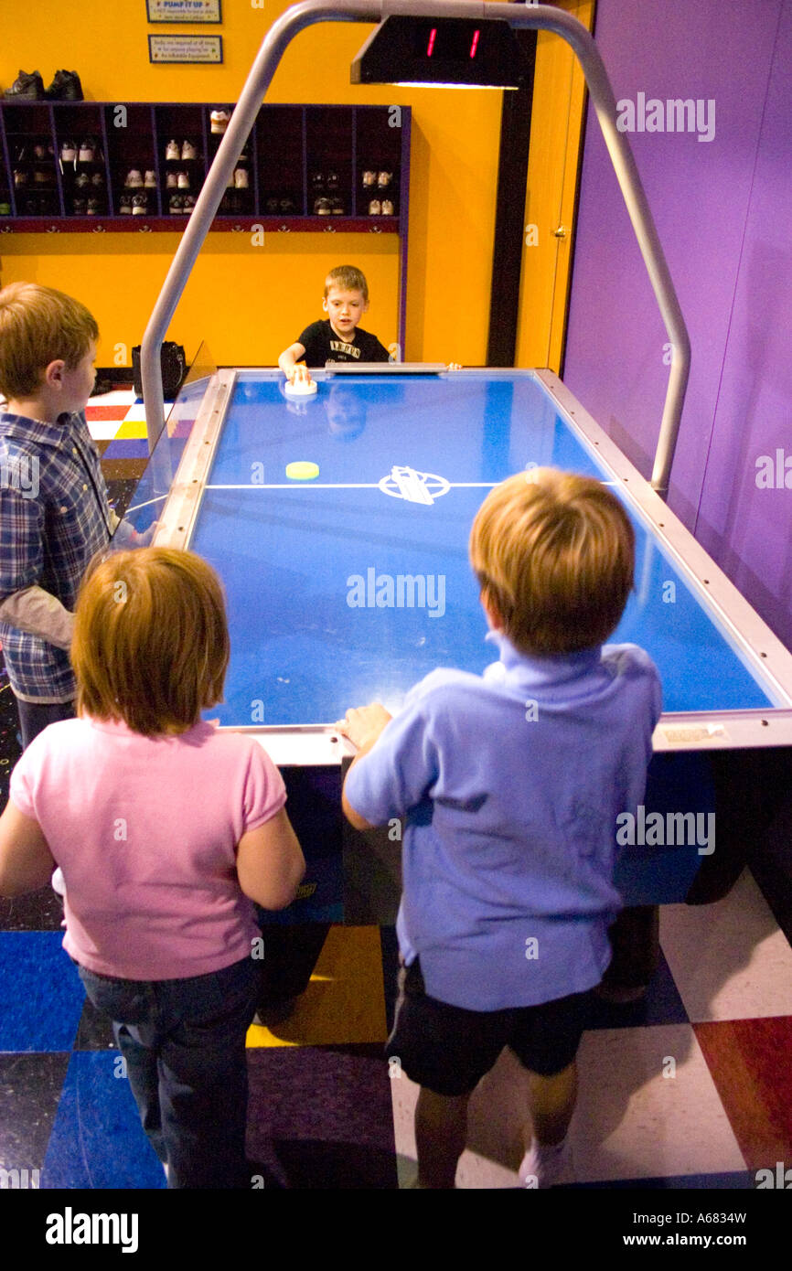 Beautiful Children Playing Air Hockey At Pump It Up   The Inflatable Party Zone    Entertainment For Children. Burnsville Minnesota USA