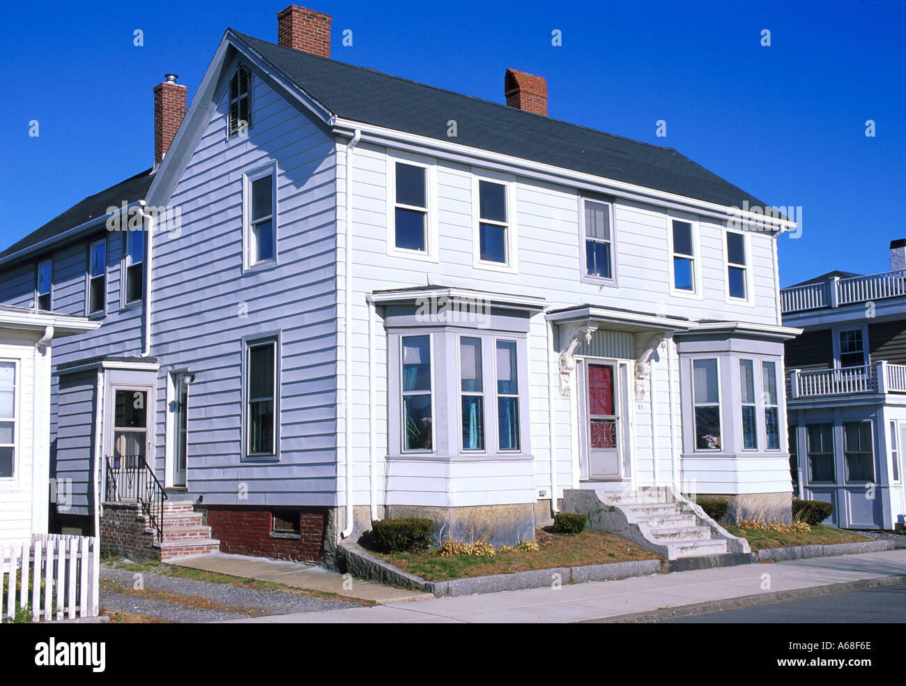A White Two Story Wood Frame House In Gloucester