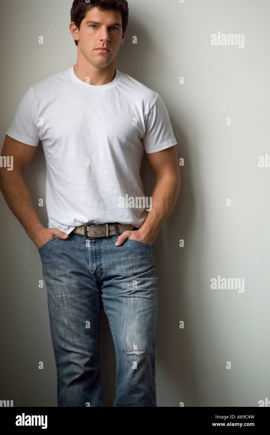 young man in white tshirt and jeans stock photo royalty