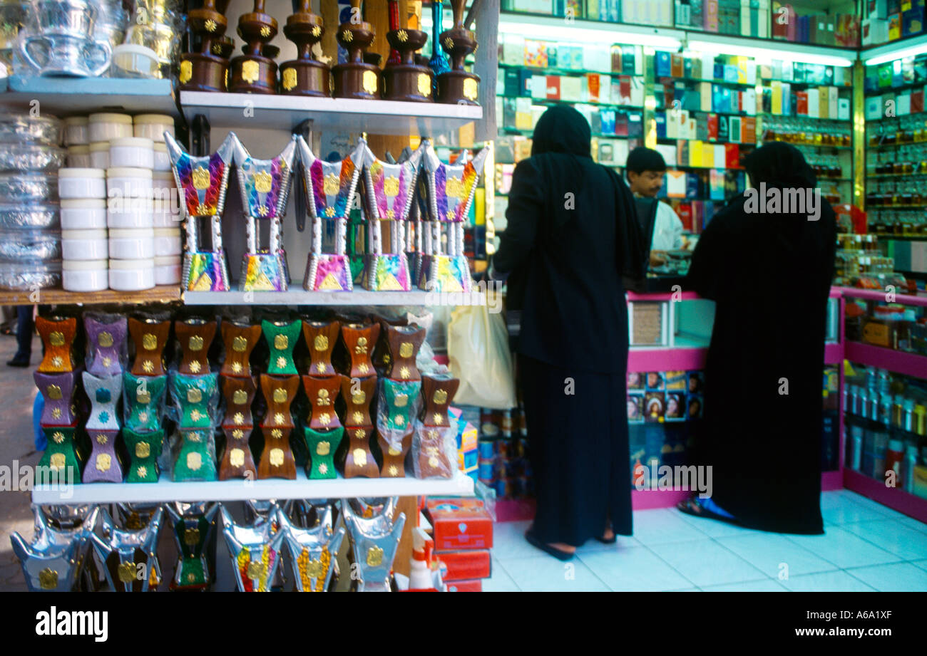 abu dhabi uae women shopping in traditional perfume shop in souk stock photo royalty free. Black Bedroom Furniture Sets. Home Design Ideas
