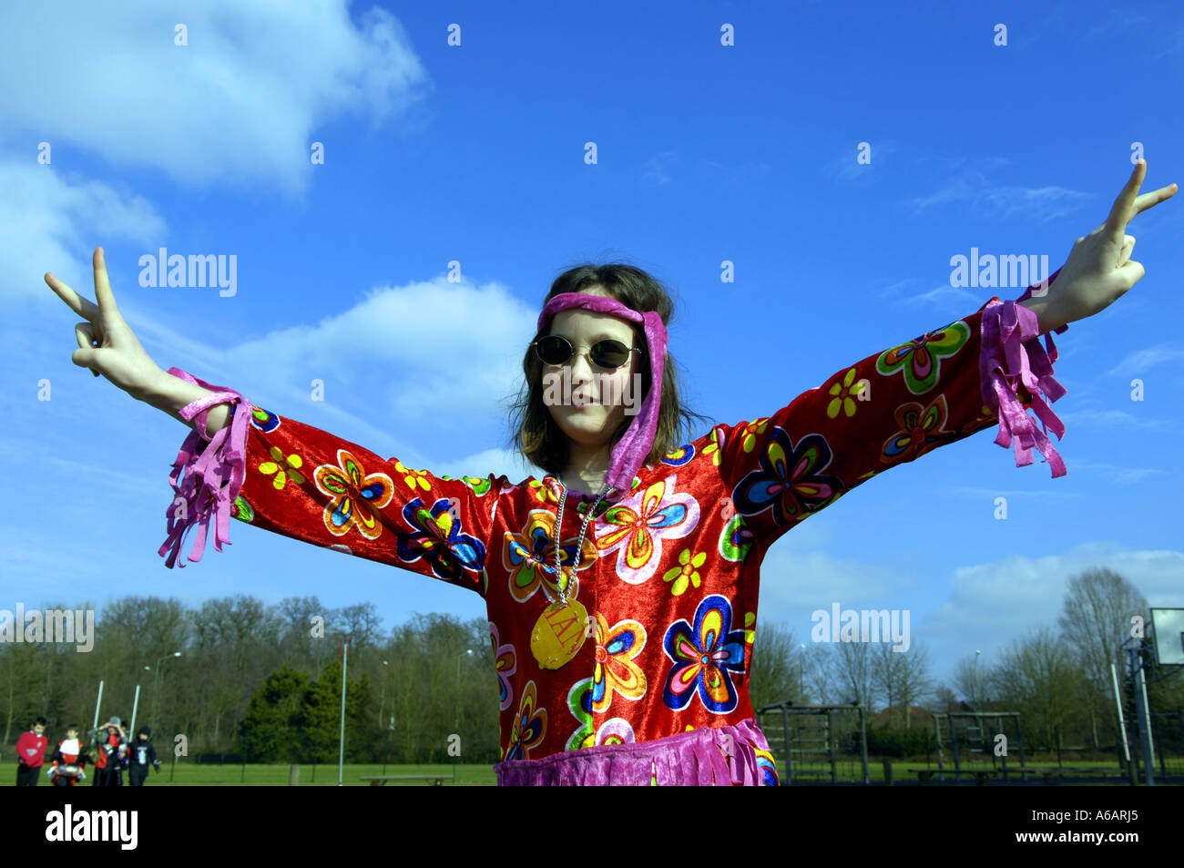 stock photo girl kid child hippy flower power europe european eec eu colour color day daylight outisde blue sky dressing up costume seventie - Colour Kid