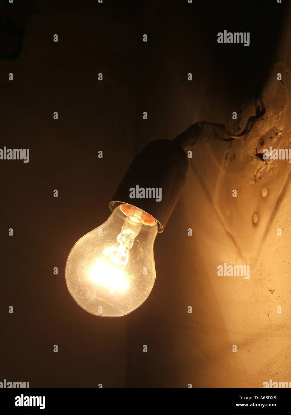 Dark room with light bulb - Stock Photo One Bare Light Bulb In Dark Room