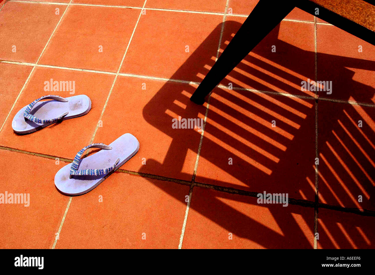 Flip Flop Chair Shadow Of Chair By Swimming Pool With Flip Flop Shoes Stock Photo