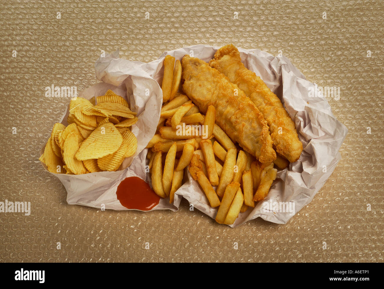 Fish chips wrapped in paper example of high fat food to be for Is fish high in cholesterol