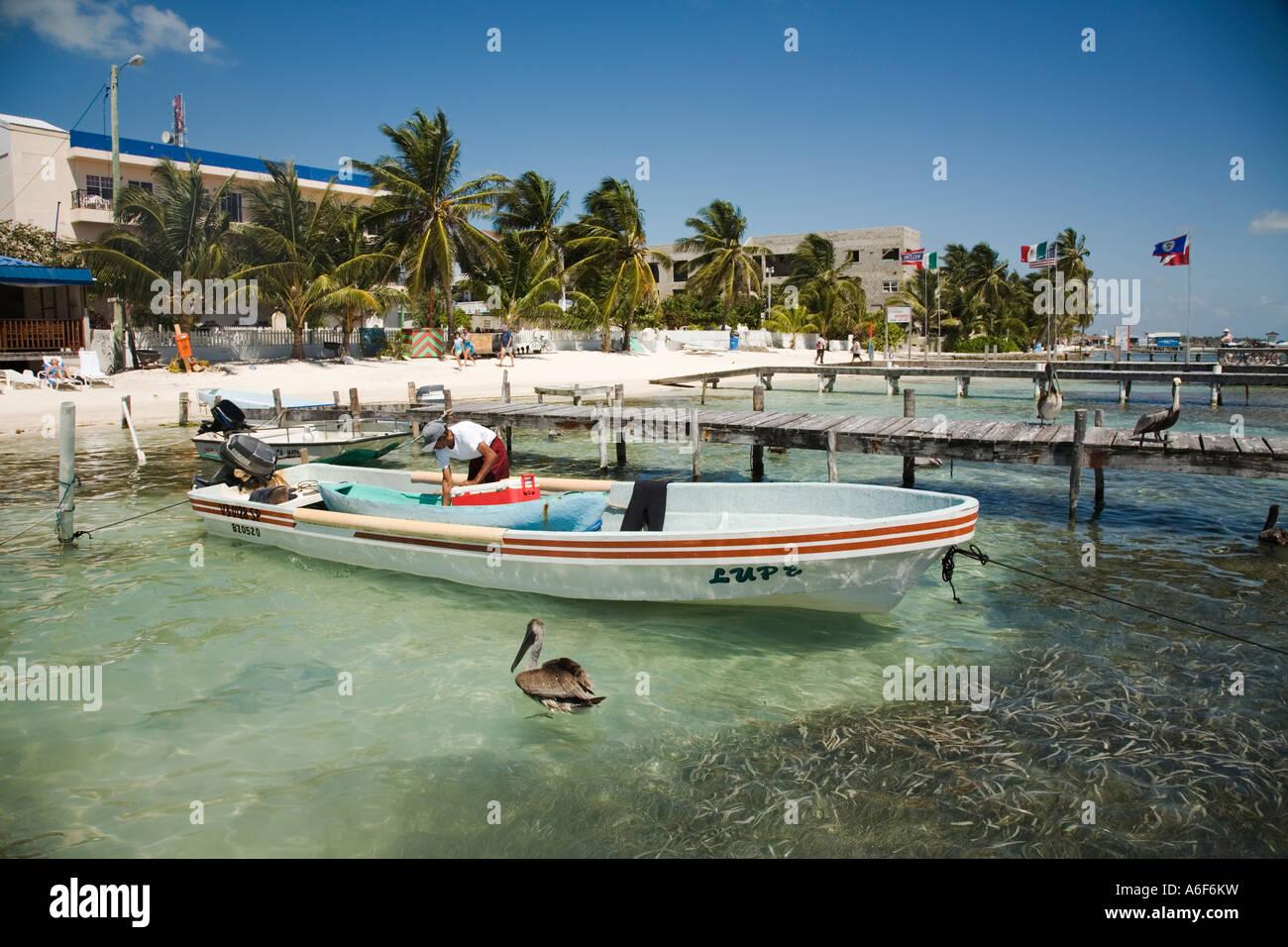 Belize san pedro ambergris caye man clean out fishing boat for Fishing san pedro belize