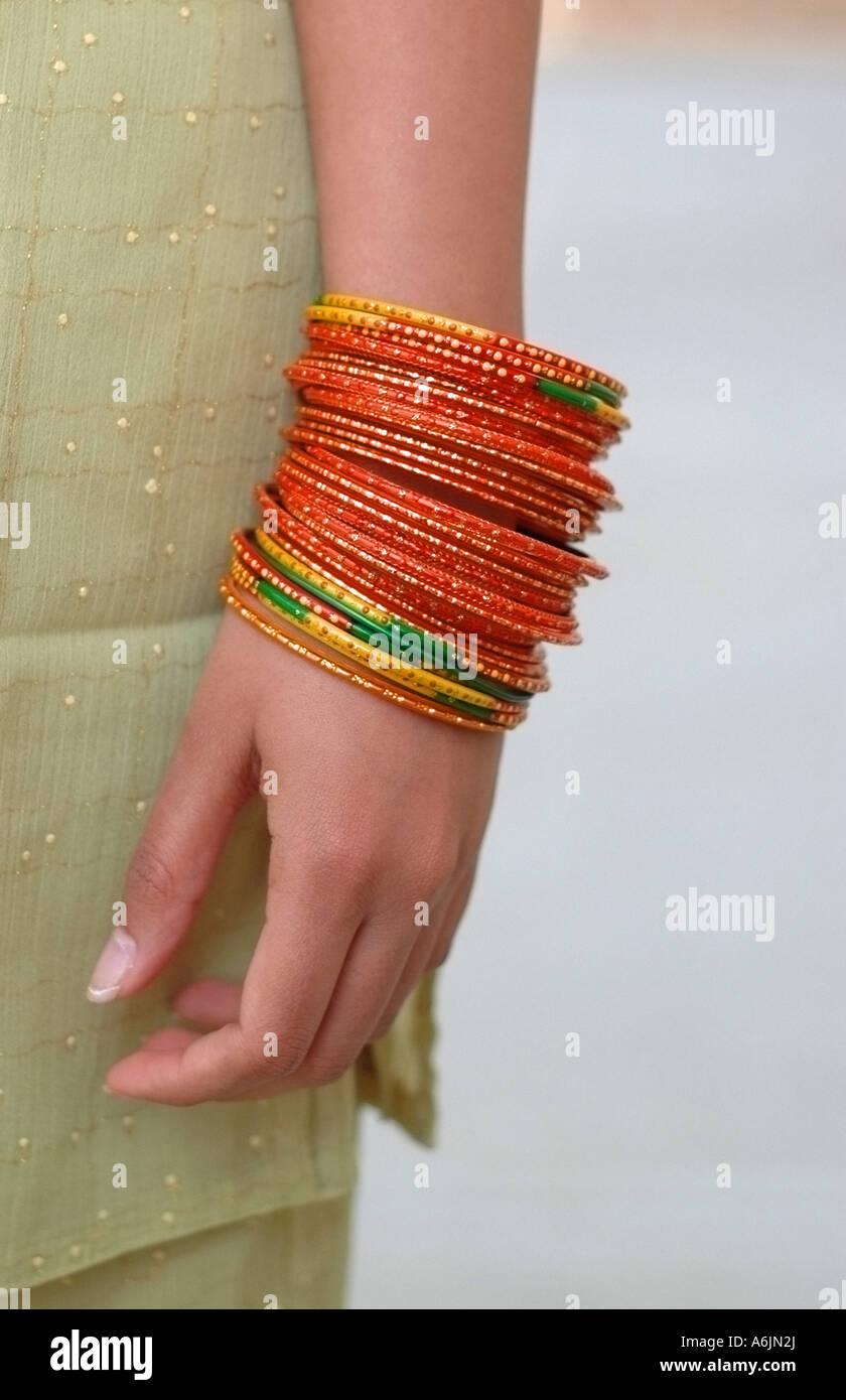 Indian Girl Wearing Bangles Stock Photos & Indian Girl Wearing ...