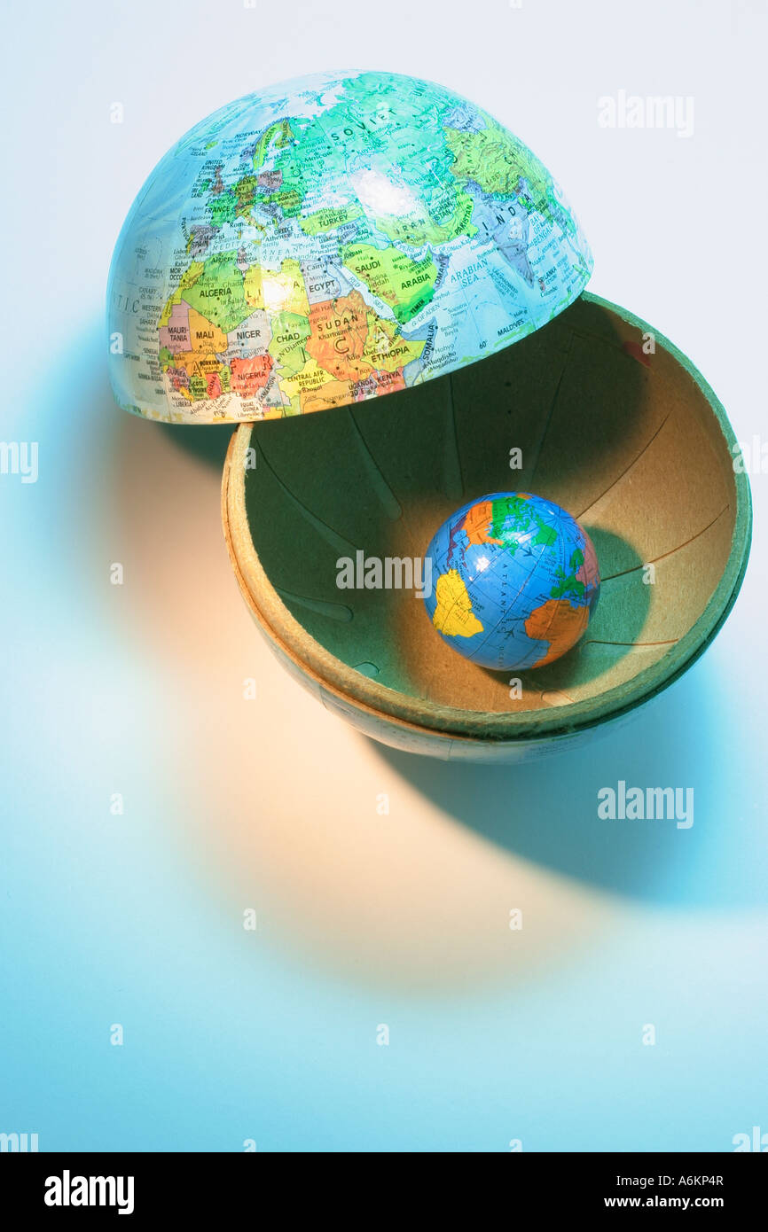 World map divided into continents stock photos world map divided mini globe in globe container stock image gumiabroncs Choice Image