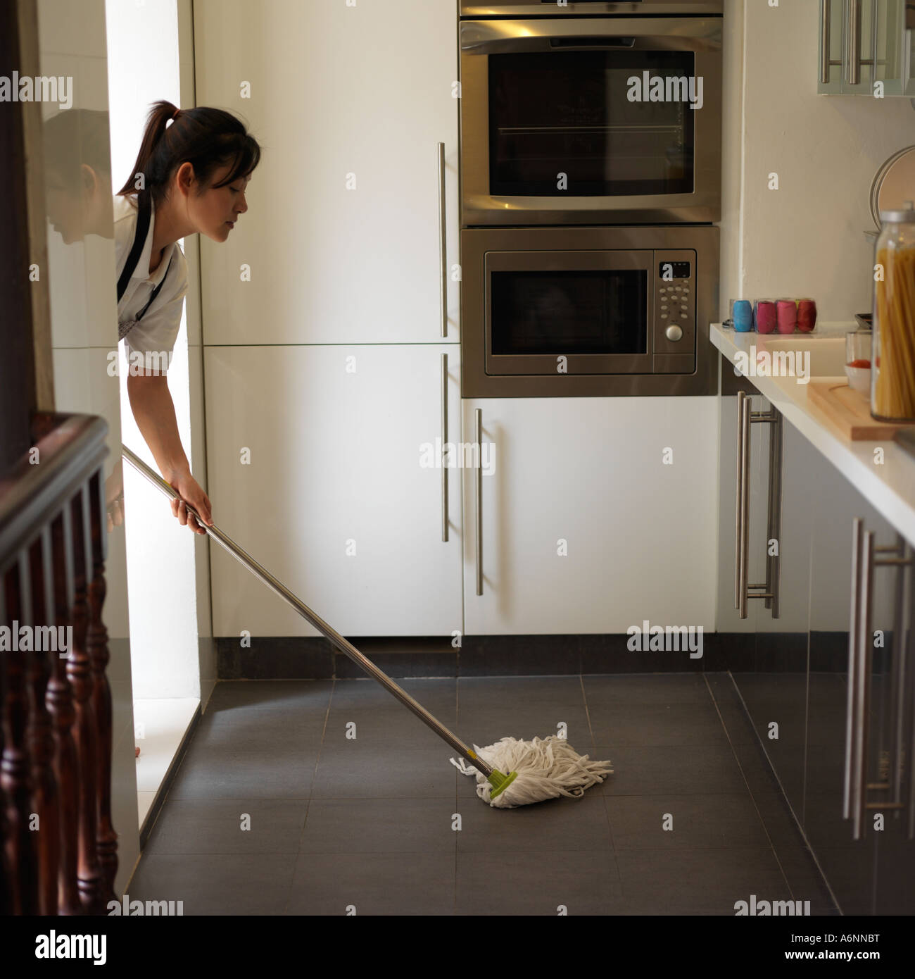 Mopping Kitchen Floor Young Woman Mopping Kitchen Floor Side View Stock Photo Royalty