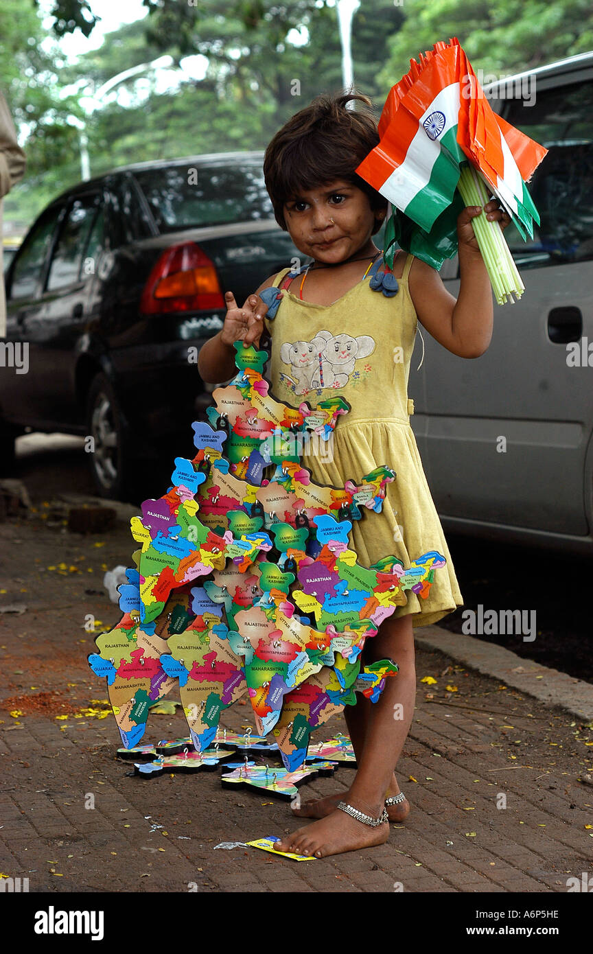ASB77273 Child labour young girl working selling Indian ...