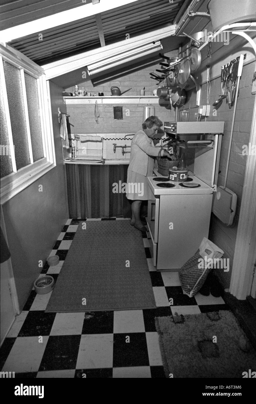 1950s Style Kitchen middle aged woman in 1950's style kitchen stock photo, royalty