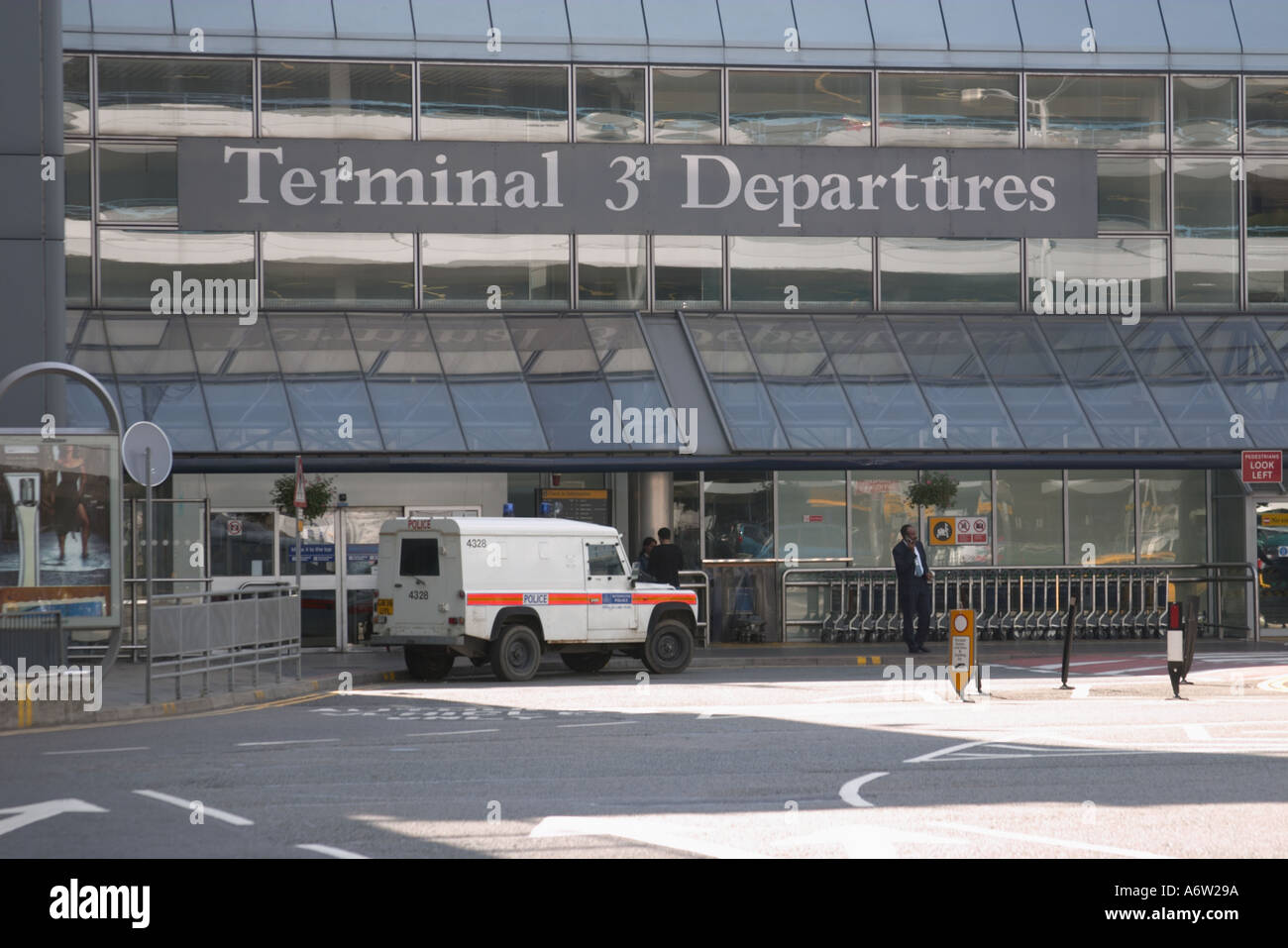 armoured police vehicle outside terminal 3 departures at