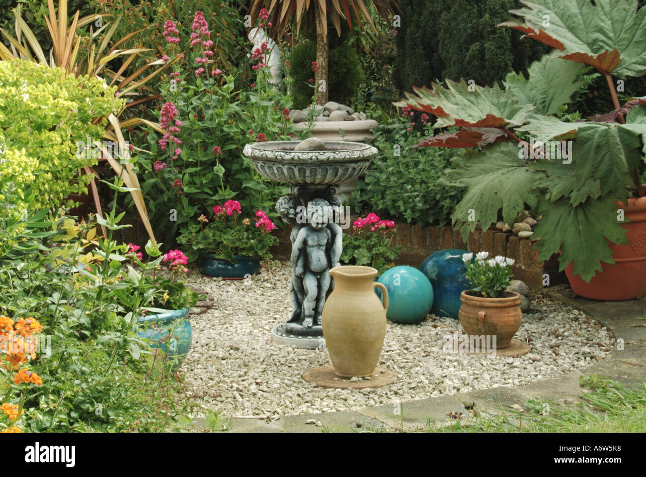 English domestic garden feature with stone chippings and for Filling in a pond