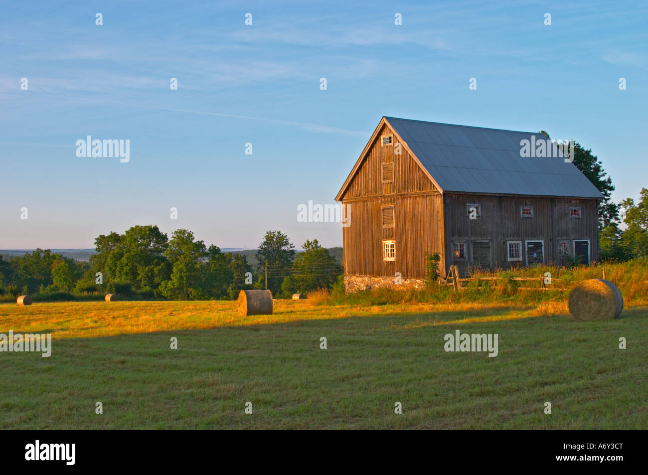 Cut Field With Hay Bales At Sunrise Old Farm House Barn Traditional Style Swedish