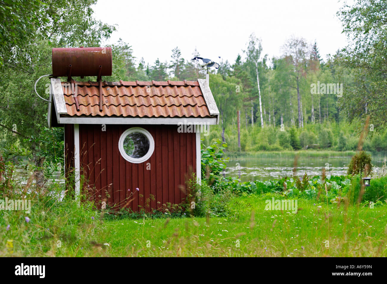 Swedish Style House traditional style swedish wooden painted house. a small water tank