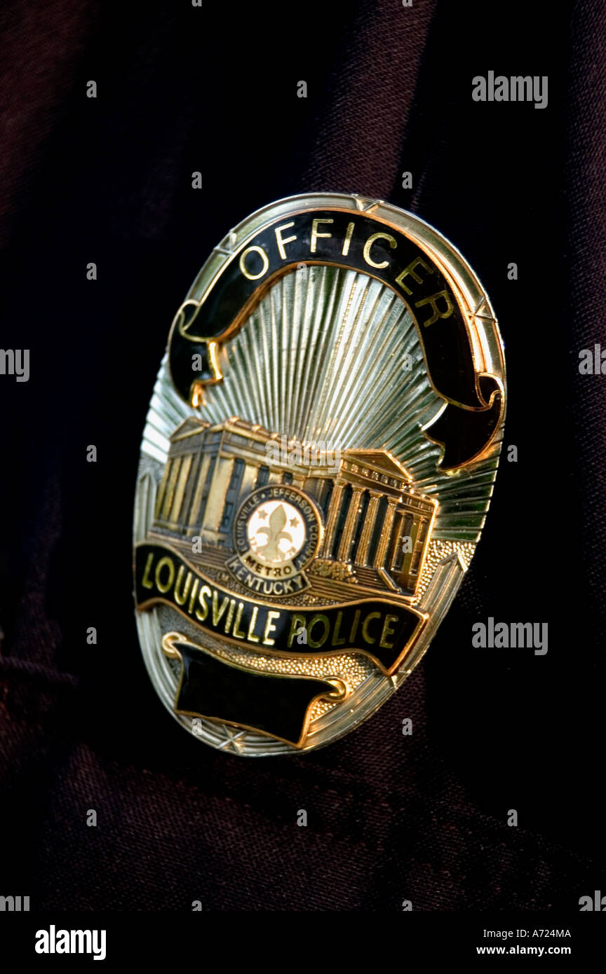 close up of louisville metro police badge on officer s uniform