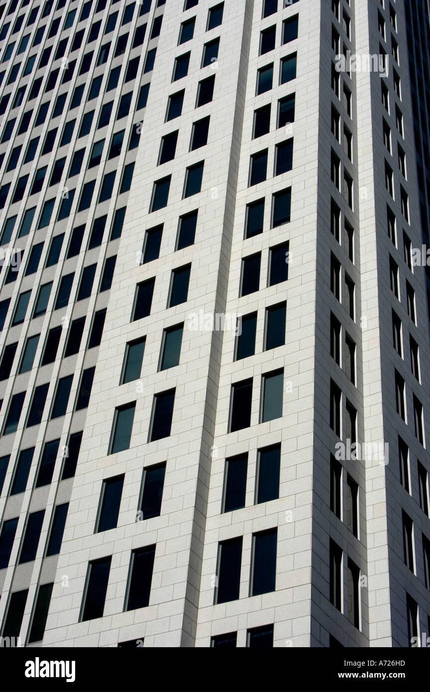 Symmetrical windows on tall city building Stock Photo ...