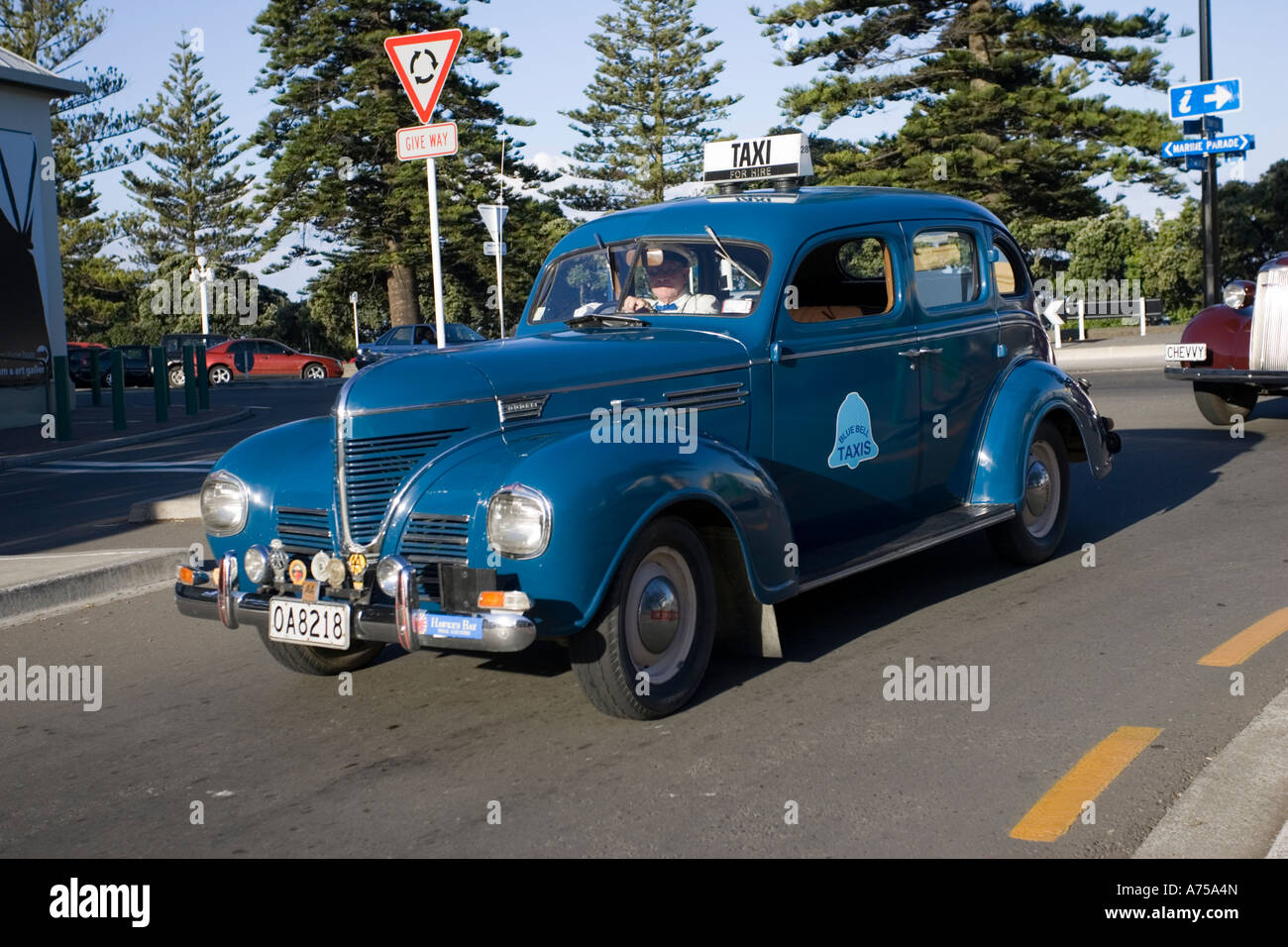 Classic Vintage Dodge Motor Car Blue Bell Taxis For Hire On Road