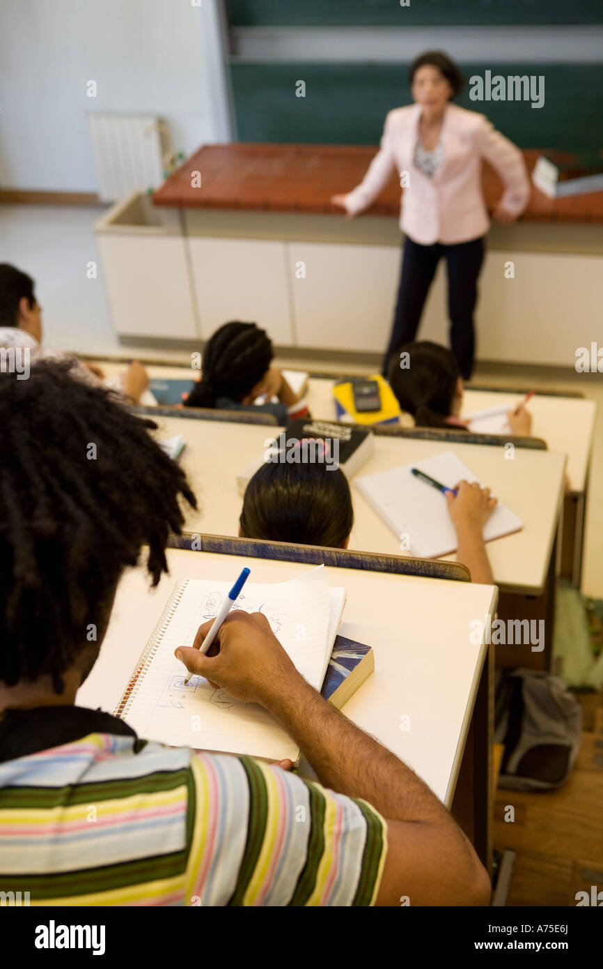 Student taking notes in class Stock Photo, Royalty Free ...