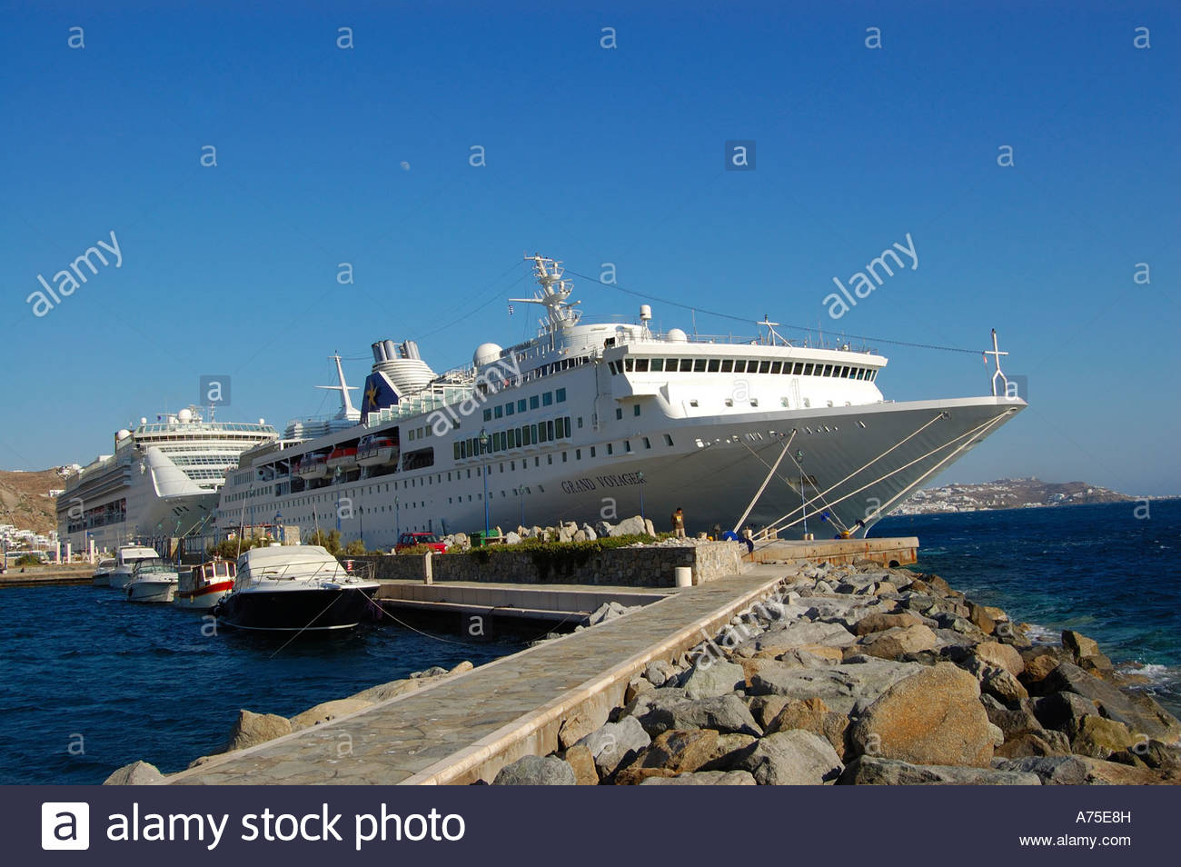 GRAND VOYAGER CRUISE SHIP IN MYKONOS GREECE Stock Photo Royalty - Grand voyager cruise ship