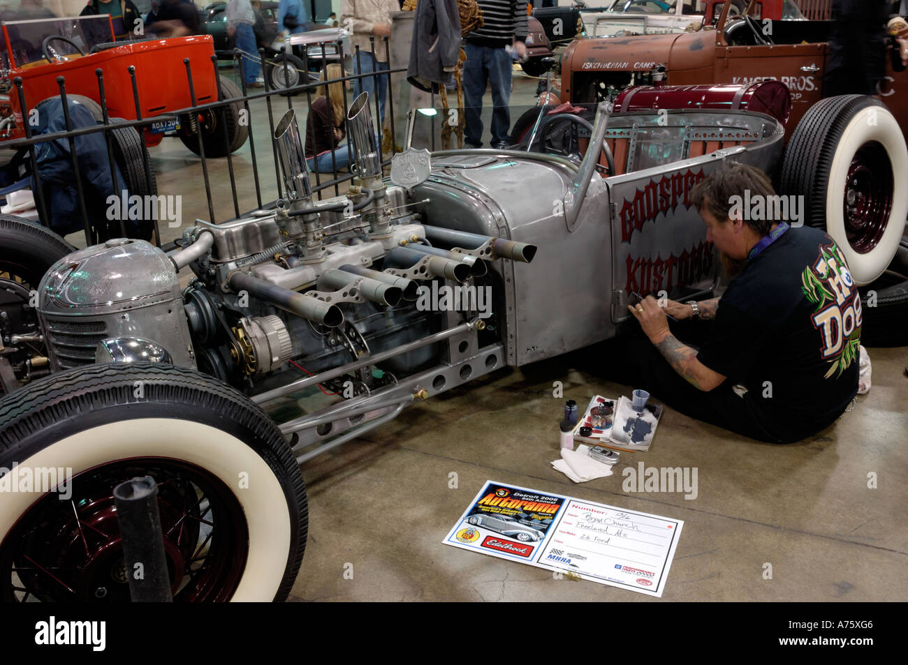 painter lettering a door on a 1926 Ford traditional hot rod at the ...