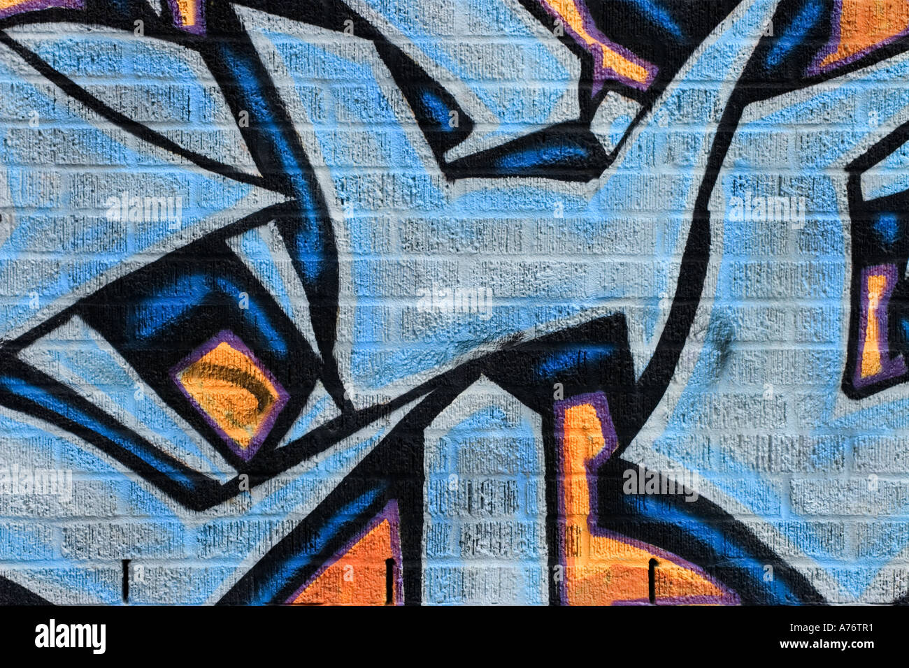 Graffiti wall painting - Stock Photo Wall Painting Brick Blue Black Orange Various Shapes And Lines Street Art Graffiti