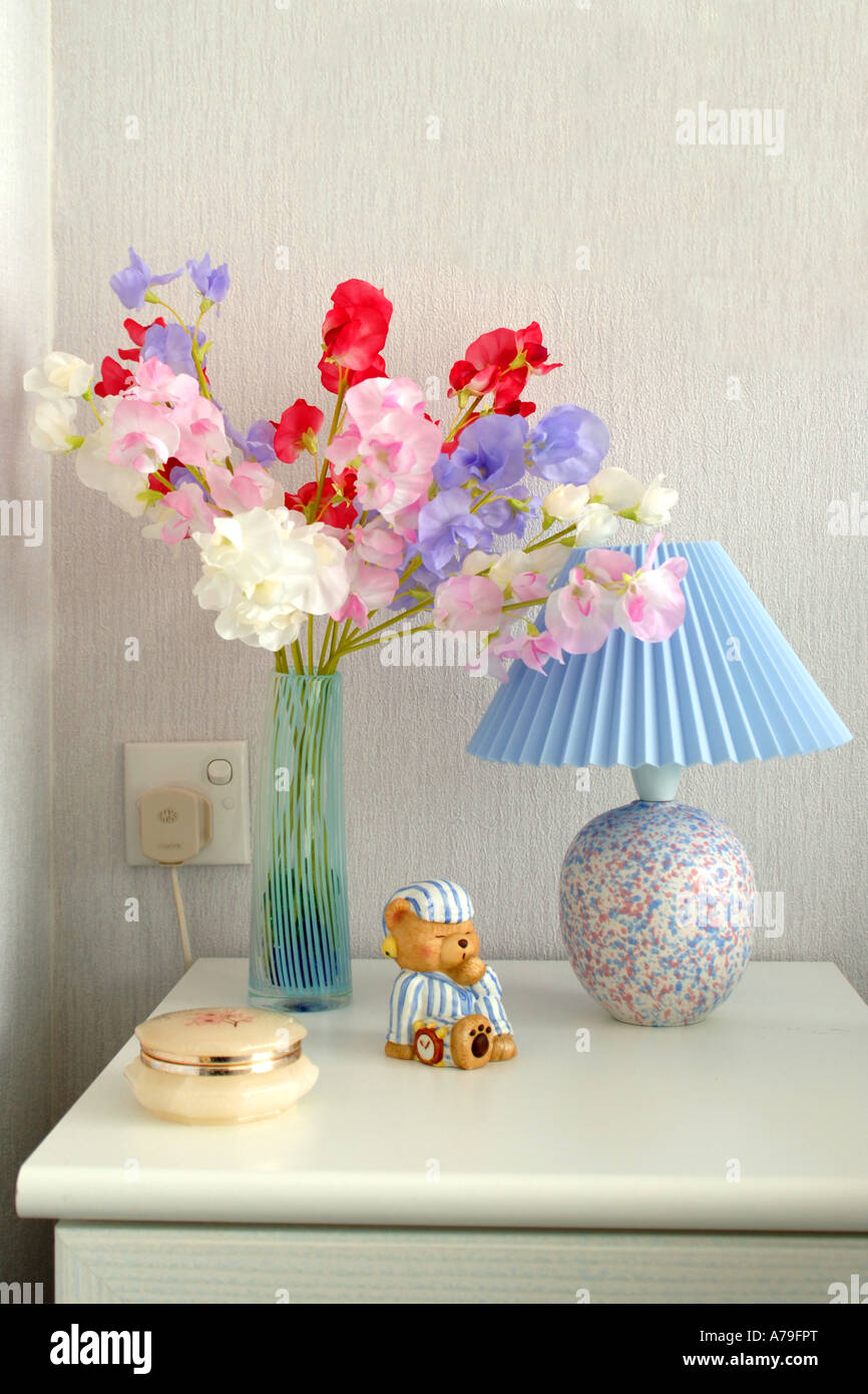 Silk flowers in a vase on a bedside cabinet as an indoor silk flowers in a vase on a bedside cabinet as an indoor decoration reviewsmspy