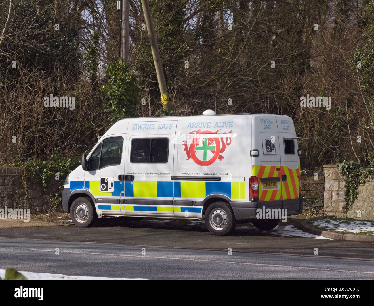 http://c8.alamy.com/comp/A7C0T0/police-mobile-speed-camera-vehicle-parked-beside-road-in-30-mph-speed-A7C0T0.jpg