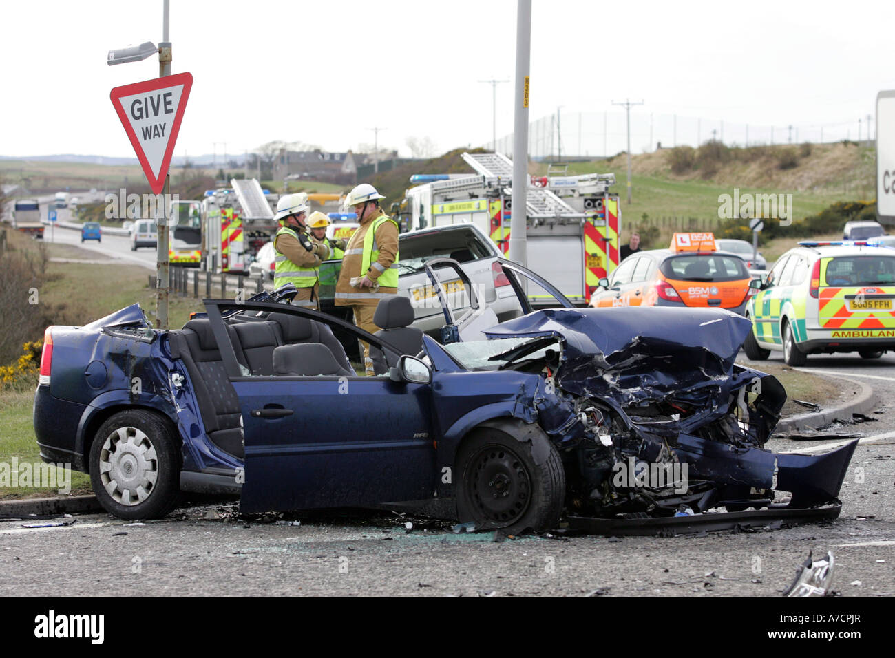 grampian police and fire officers at scene of bad car crash on a90 in aberdeenshire scotland uk