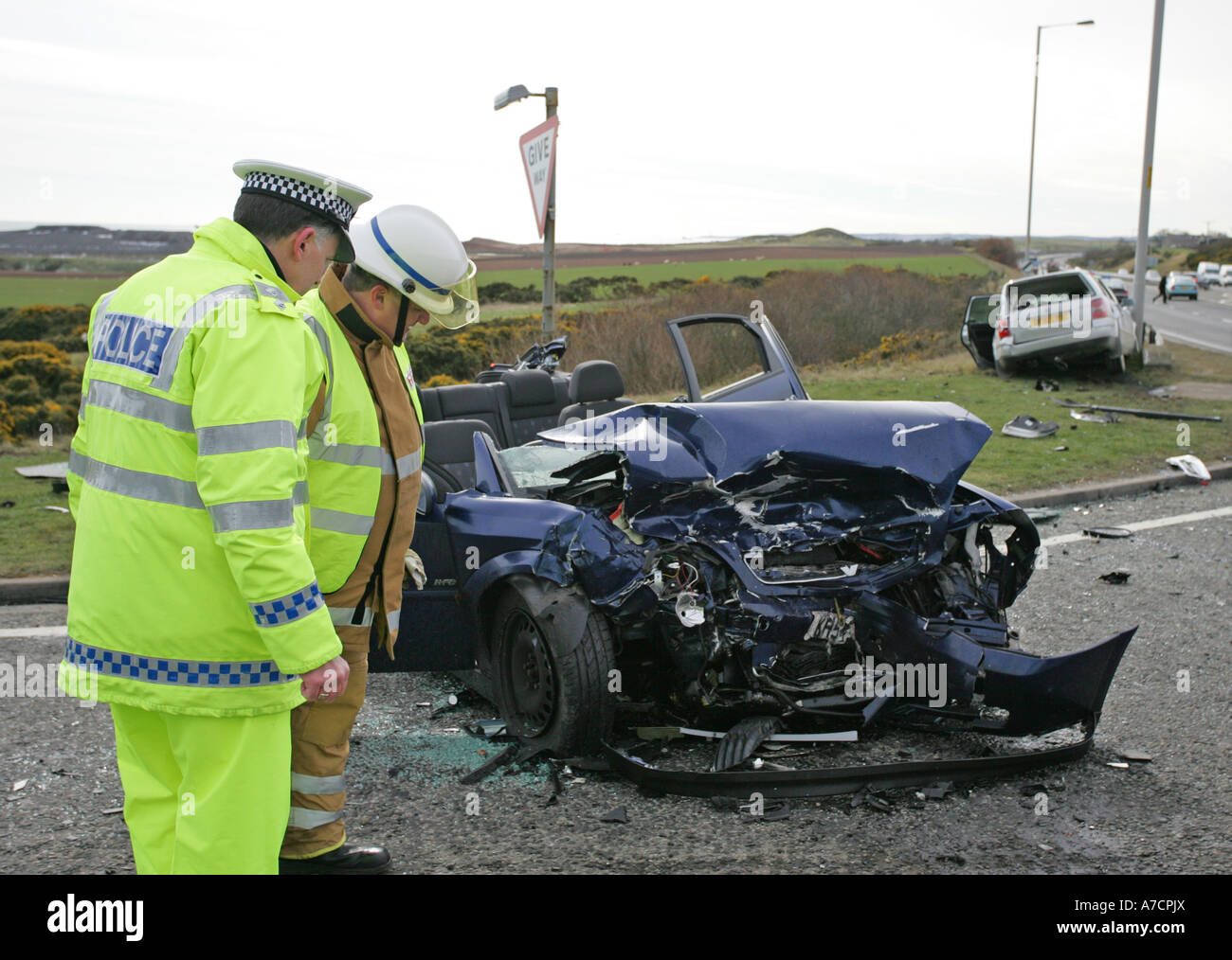 grampian police and fire officers at scene of bad car crash on a90 in aberdeenshire