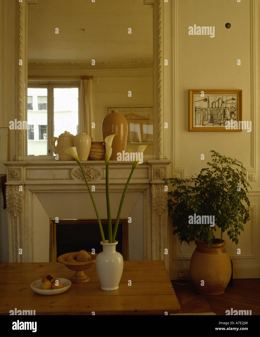 White Lilies In Vase On Table Front Of Fireplace Below Large Mirror Traditional Sittingroom