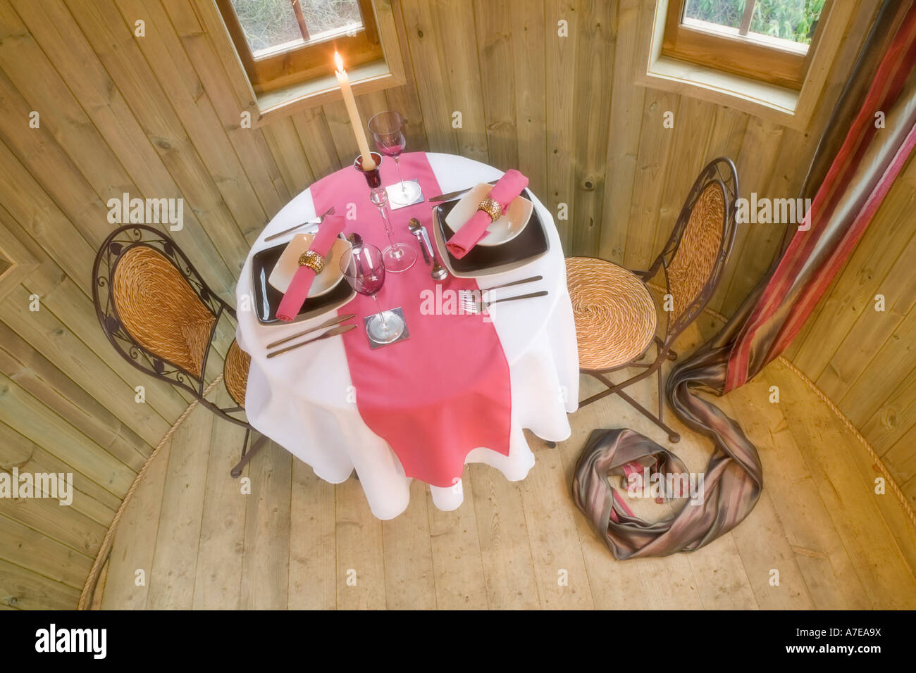How to set a romantic dinner table for two - Treehouse Interior With Dining Table Set For A Romantic Dinner For Two Stock Image
