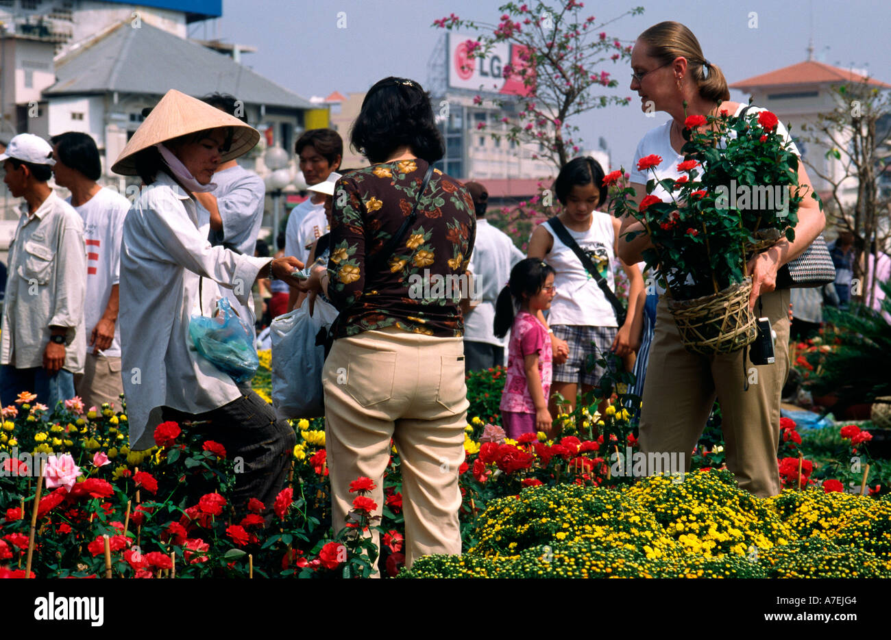 feb 1, 2003 - tourist buying flower pot at the flower market near
