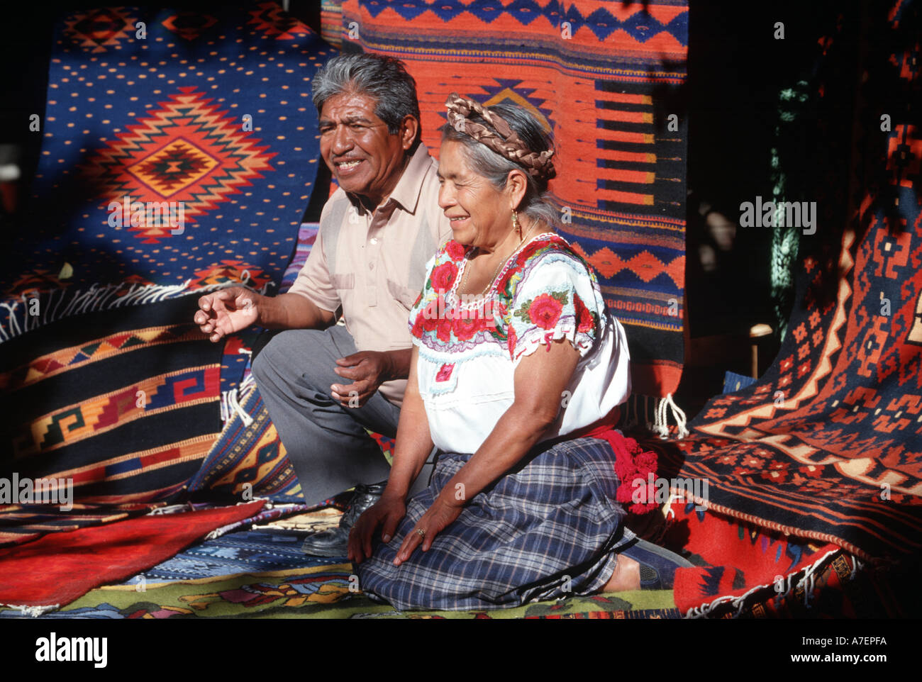 Mexico, Oaxaca, Teotitlan Del Valle. Couple Displays Their Hand Woven,  Zapotec Indian Rugs. (MR)