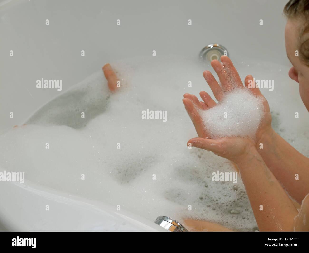 woman taking bubble bath foam bath Stock Photo, Royalty Free Image ...