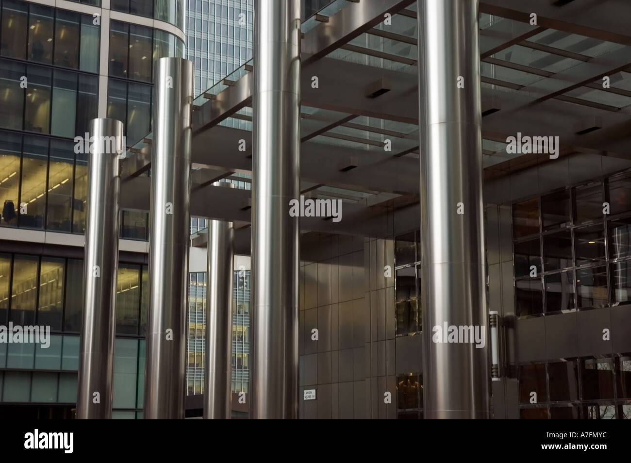 Black Metal Pillar Building : Metal pillars outside modern office building stock photo