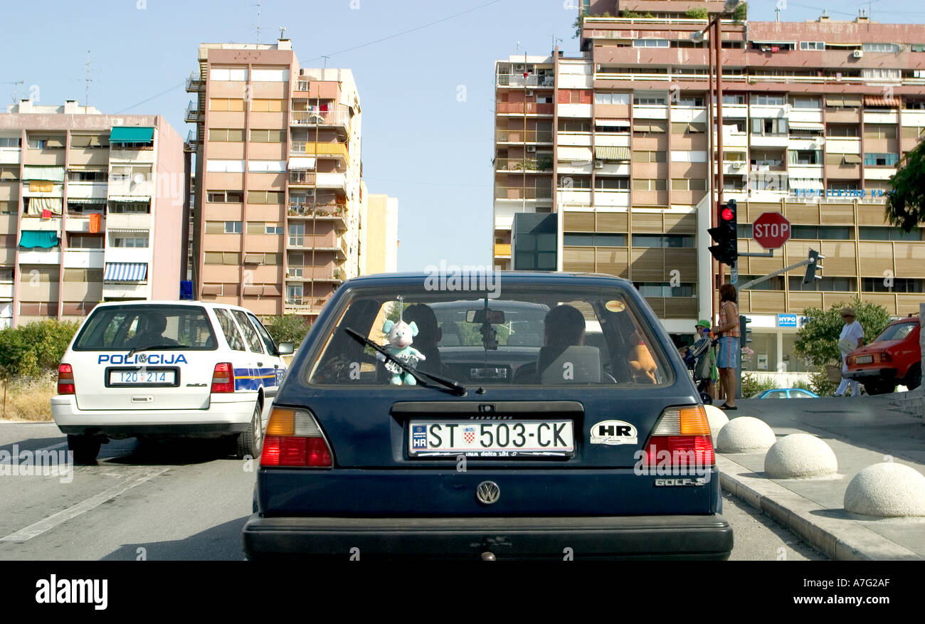 Police Car And Other Cars Waiting At Traffic Lights In Split
