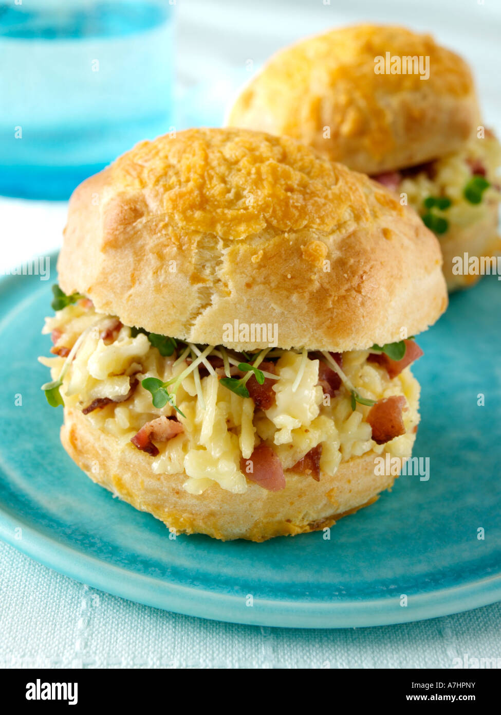 Two bacon mayonnaise and cheese scones with mustard cress ...