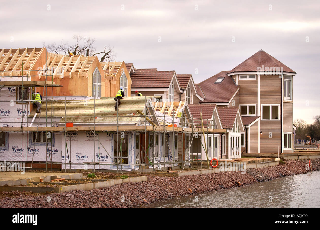 CONSTRUCTION OF NEW ENGLAND STYLE KIT HOUSES AT WINDRUSH LAKE THE WATERMARK DEVELOPMENT SOUTH CERNEY NEAR CIRENCESTER GLOUCESTER