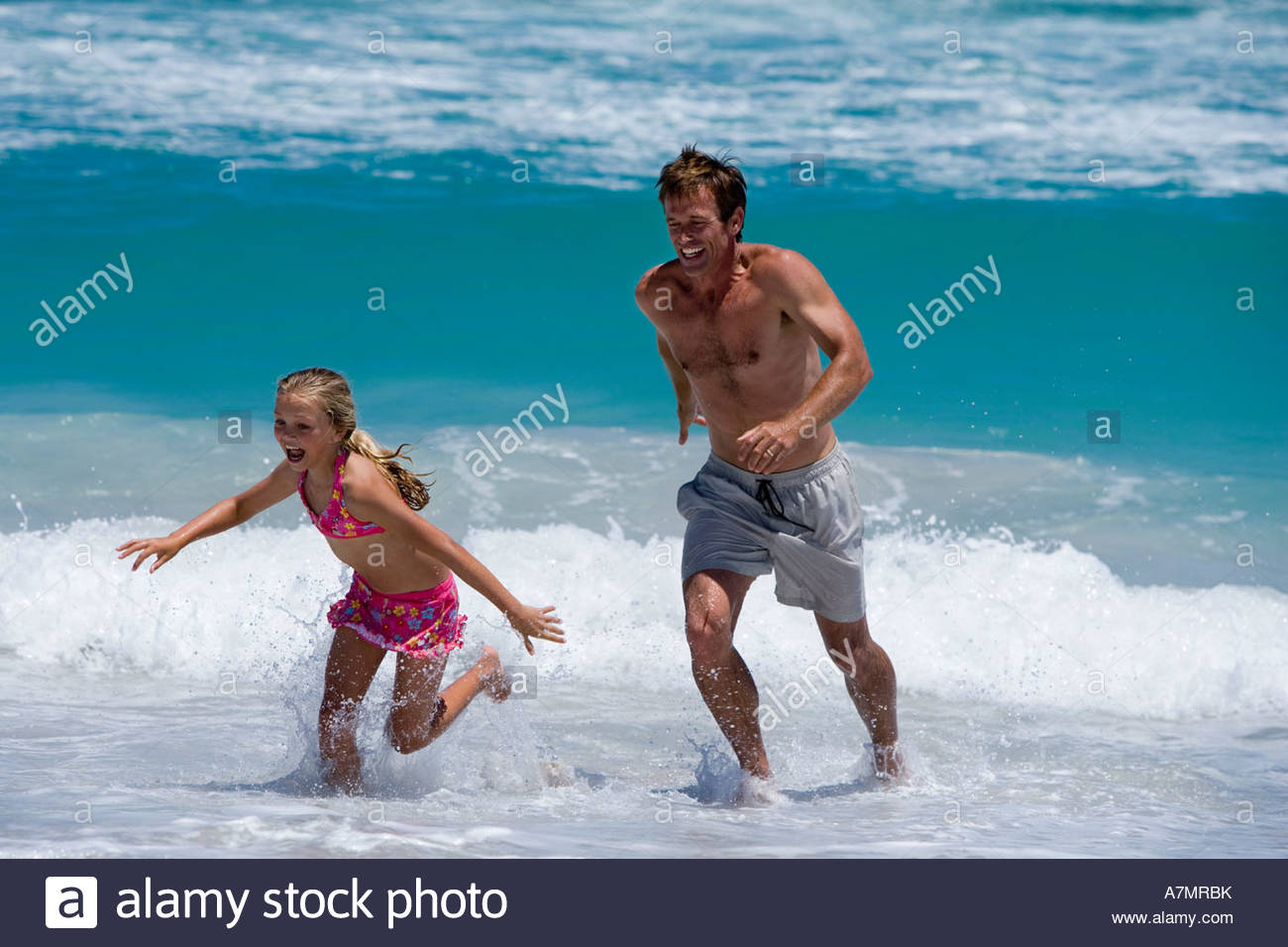 Woman running away from man