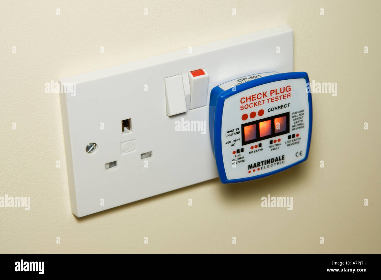 neon light mains tester plugged into a 13 amp socket to check that it Stock Photo, Royalty Free ...