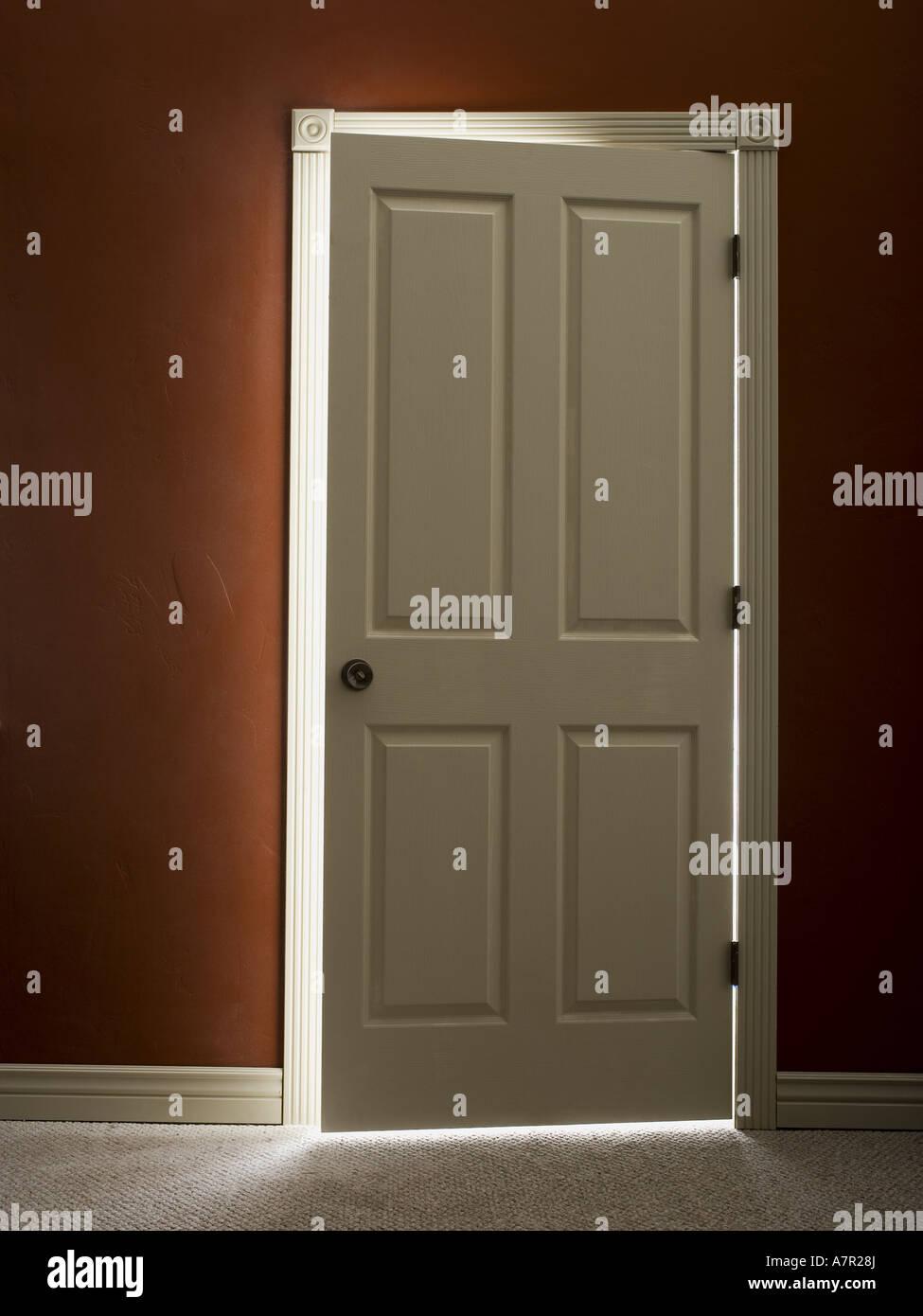 Door slightly ajar with light & Door slightly ajar with light Stock Photo Royalty Free Image ...