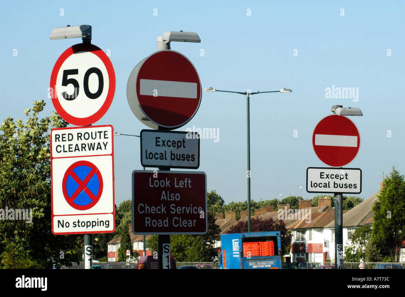 confusing road signs at a busy junction in south london