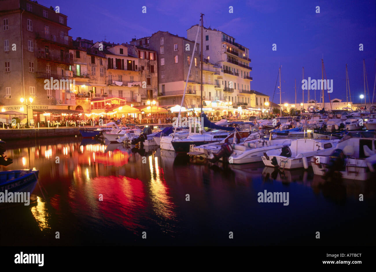 Cafe in the vieux port terra vecchia bastia corsica france stock - Boats Moored At Harbor At Night Bastia Corsica France