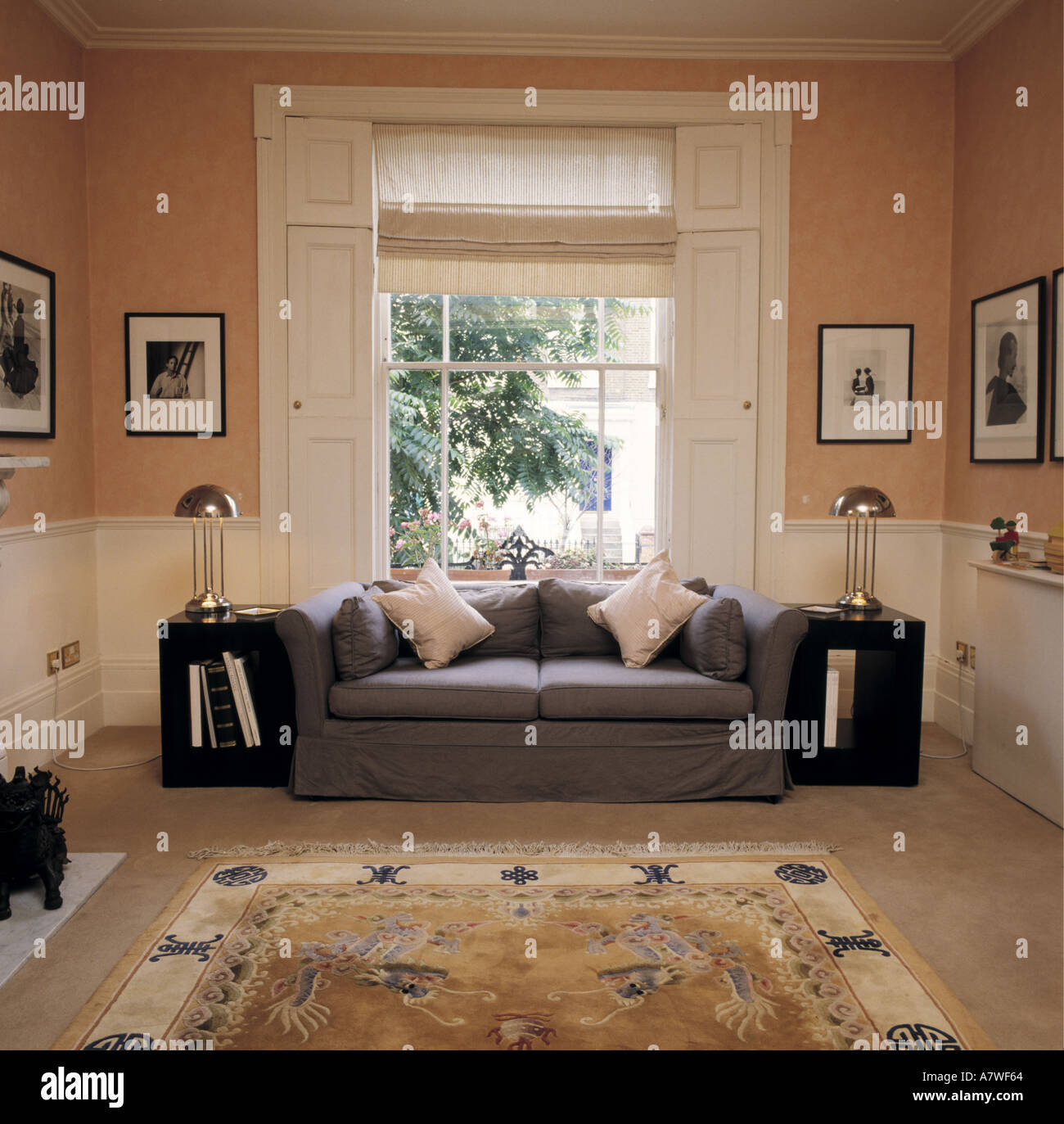 Peach Living Room Grey Sofa In Front Of Window With White Shutters And Blind In